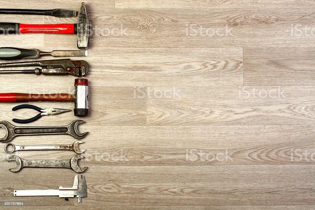 Set of tools over a wood panel. stock photo