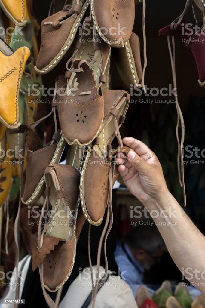 Set of traditional hand made leather shoes in bazaar stock photo