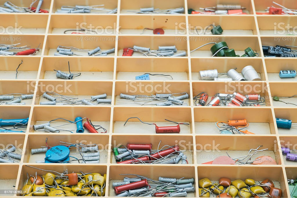 Set of various capacitors in small parts storage. stock photo