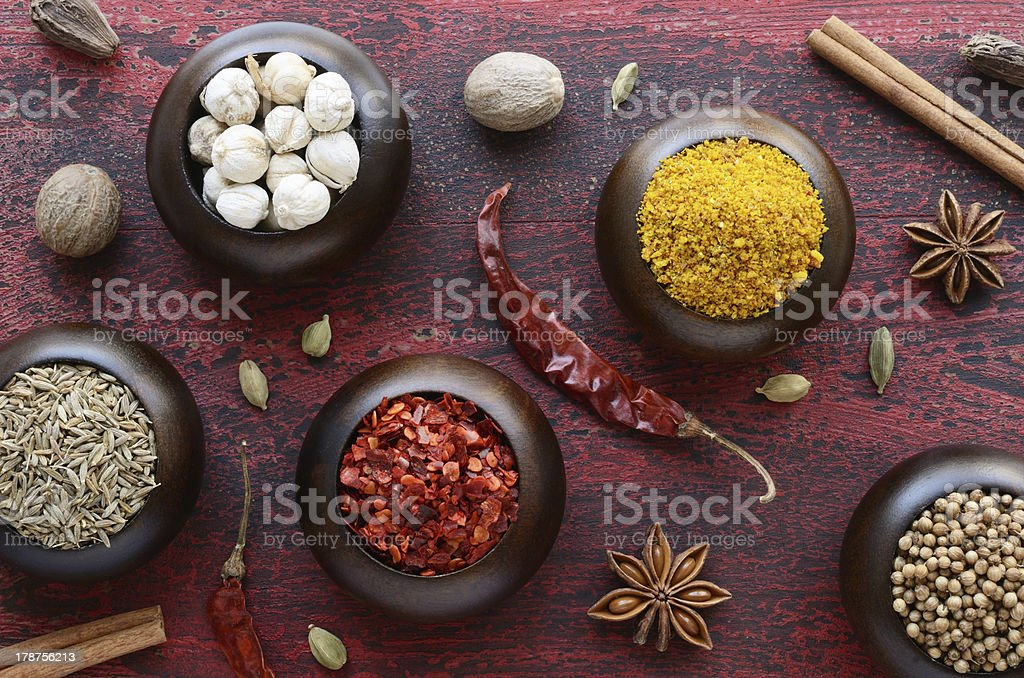 Set of various Indian spices on rusted wooden background royalty-free stock photo