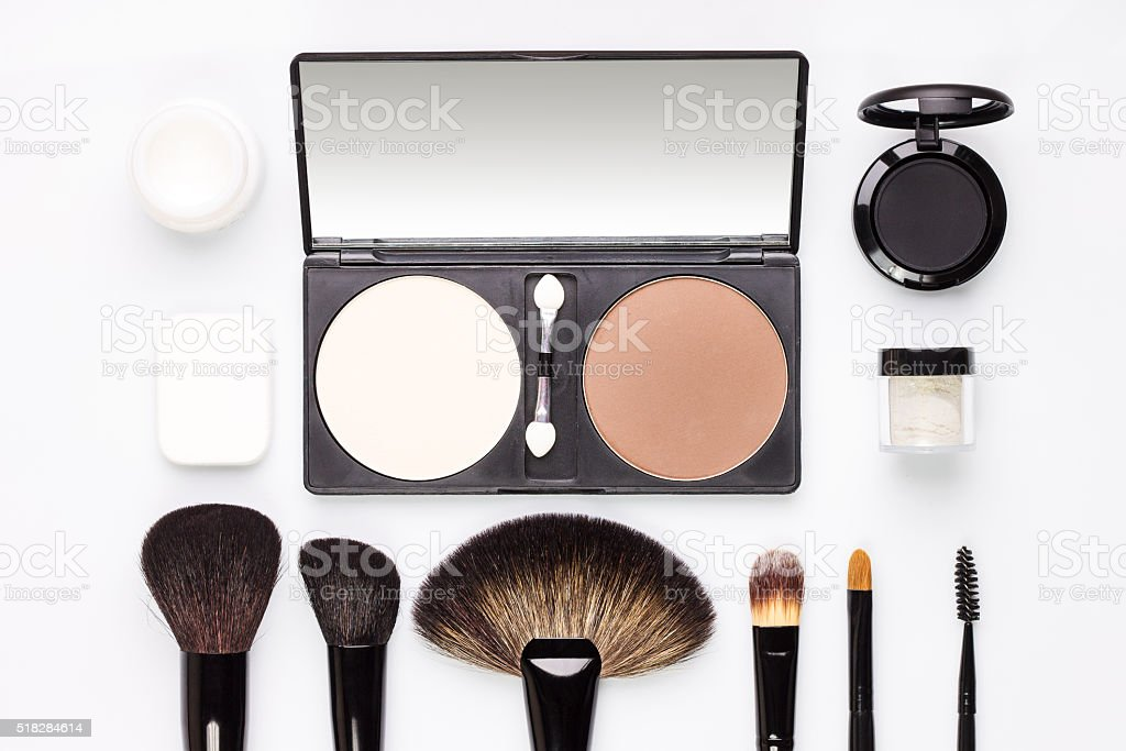 Set of various makeup brushes with eyeshadows and rouge stock photo