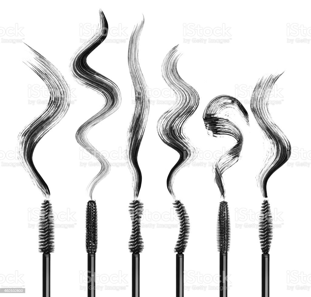 Set of various mascara brushes with strokes on white stock photo