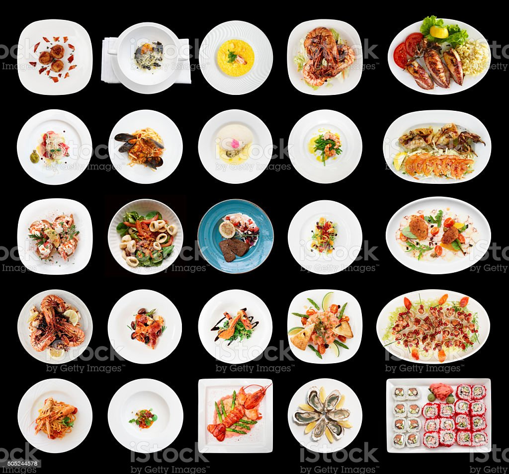Set of various seafood dishes isolated on black stock photo