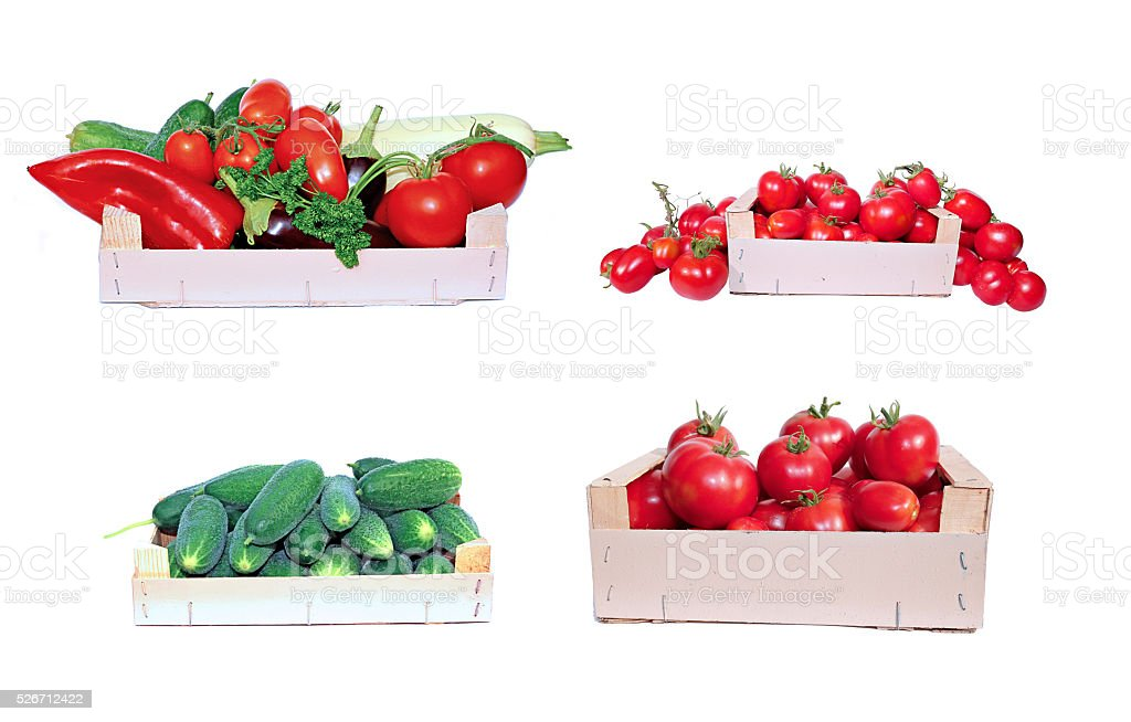 Set of vegetables, tomatoes and cucumbers in boxes stock photo
