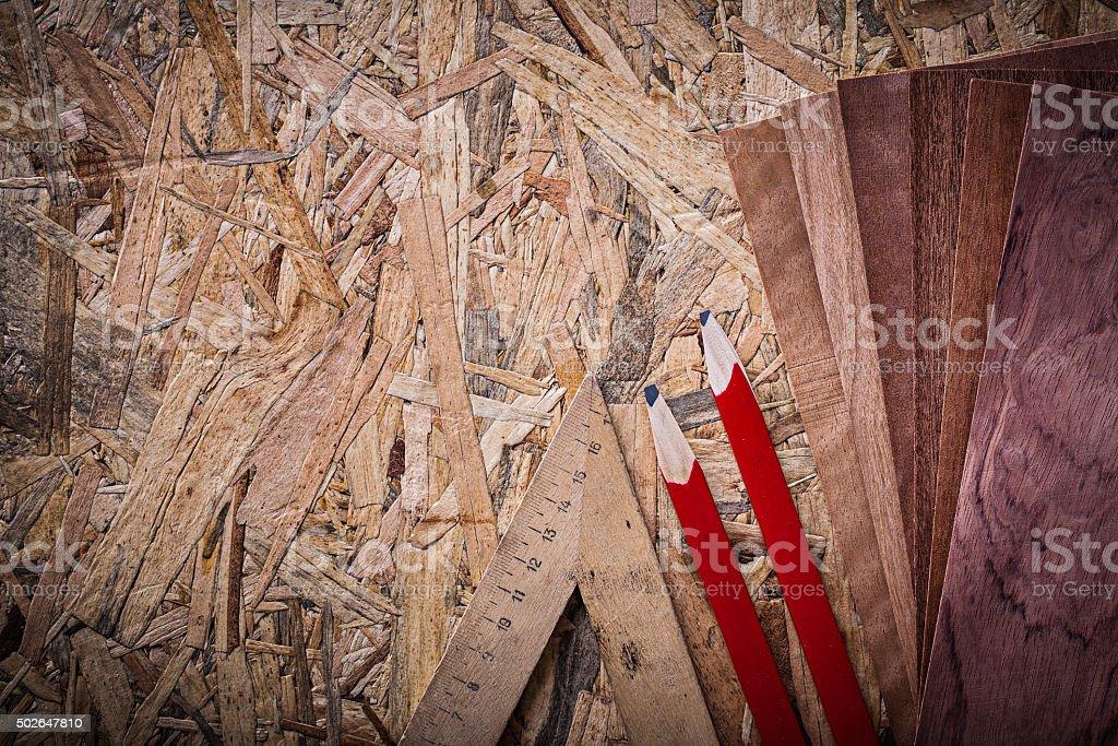 Set of veneer ruler pencils on wooden board construction concept stock photo
