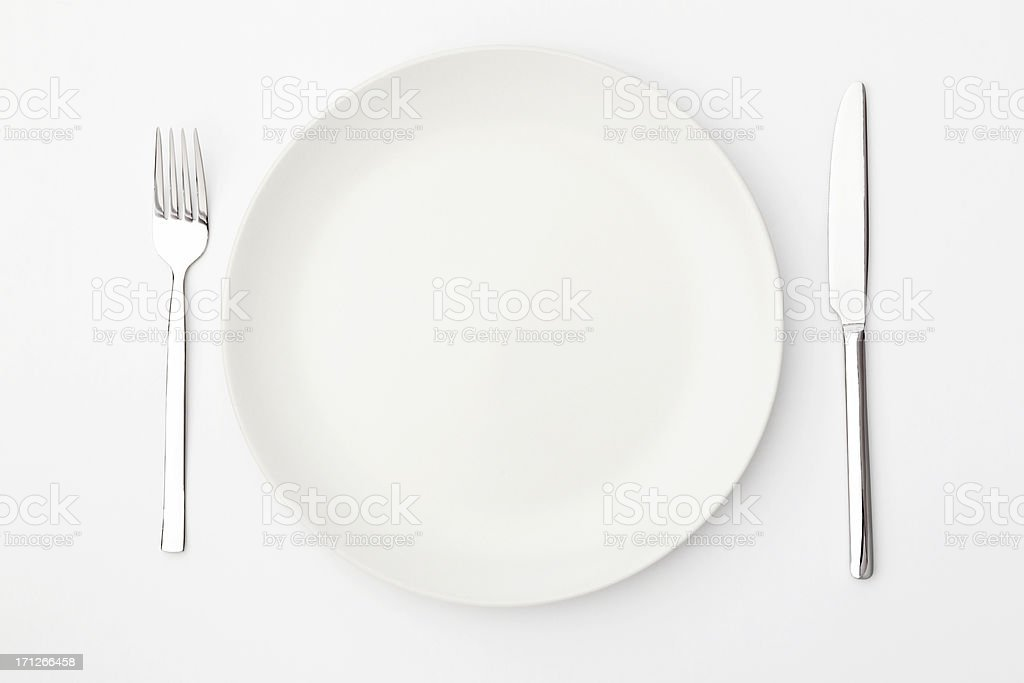 Set of white dining ware including china and silverware royalty-free stock photo
