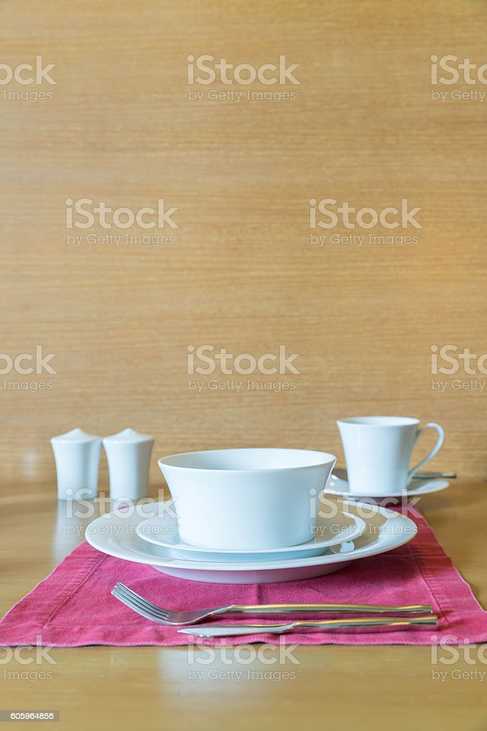 Set of white plate and table setting in hotel room stock photo