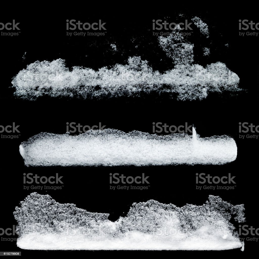 Set of white snow patterns isolated on black backround stock photo