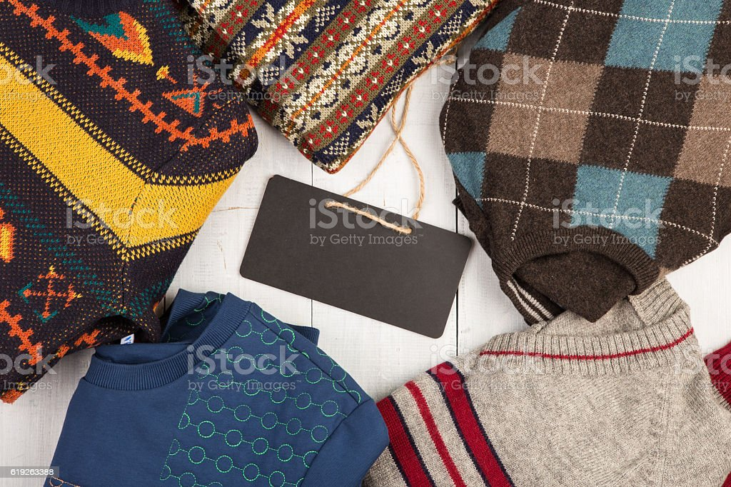 Set of winter pullovers with different ornament and signboard stock photo