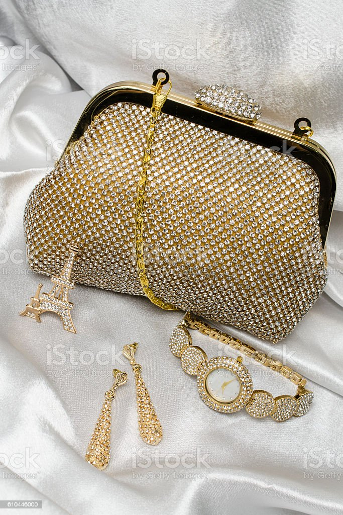 set of women's accessories on a silk background stock photo