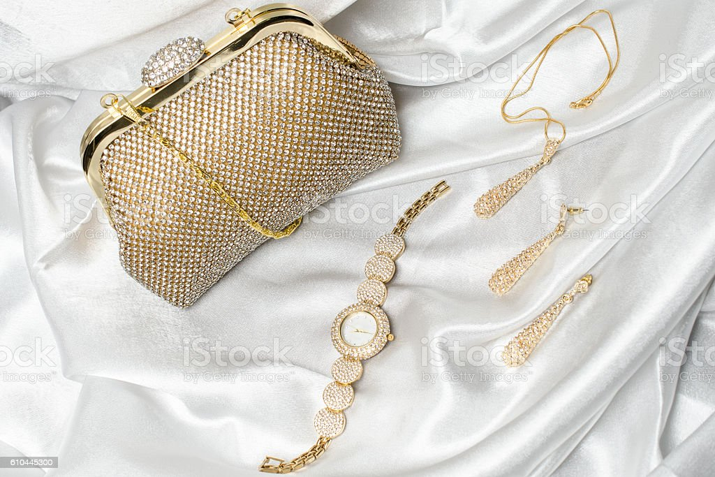 set of women's accessories on a white silk background stock photo