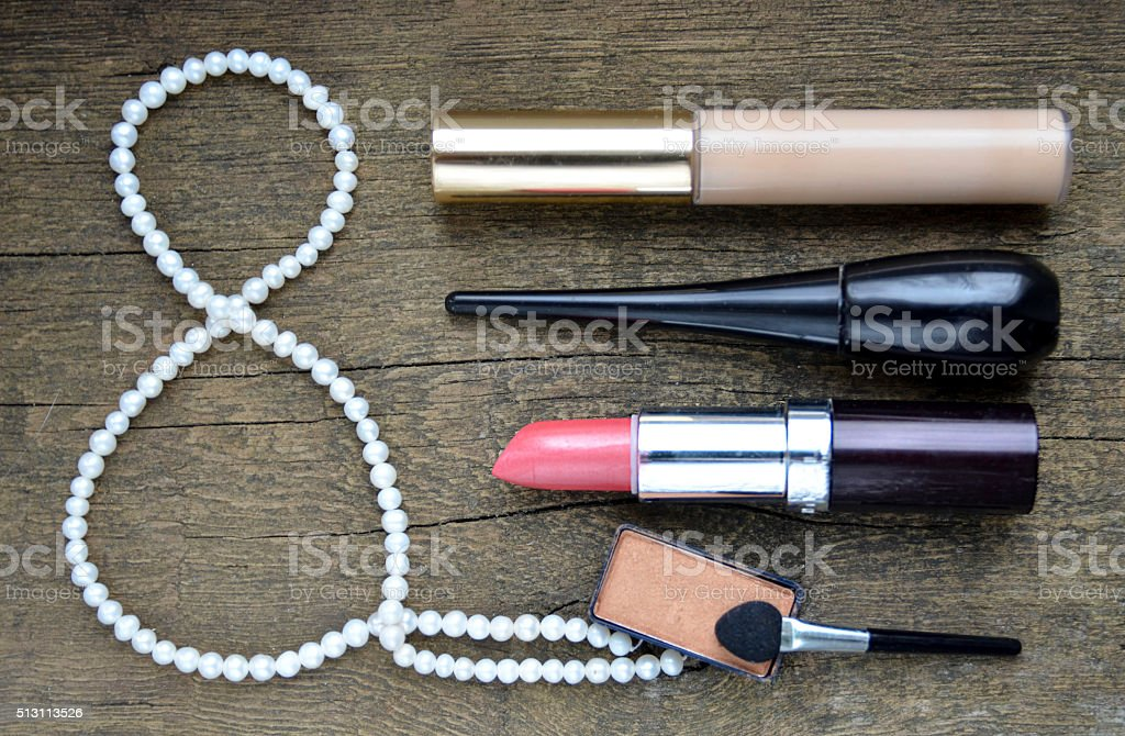 Set of women's cosmetics and pearl necklace. stock photo