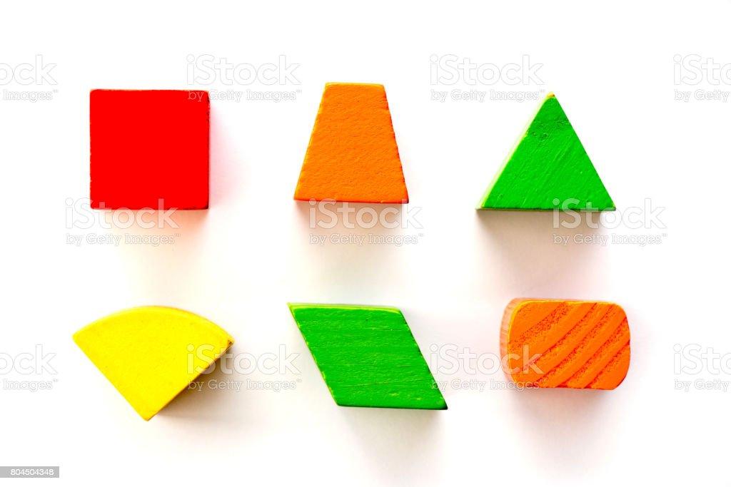 Set of wood shape toy block (square, triangle, trapezoid, oval) on white background stock photo
