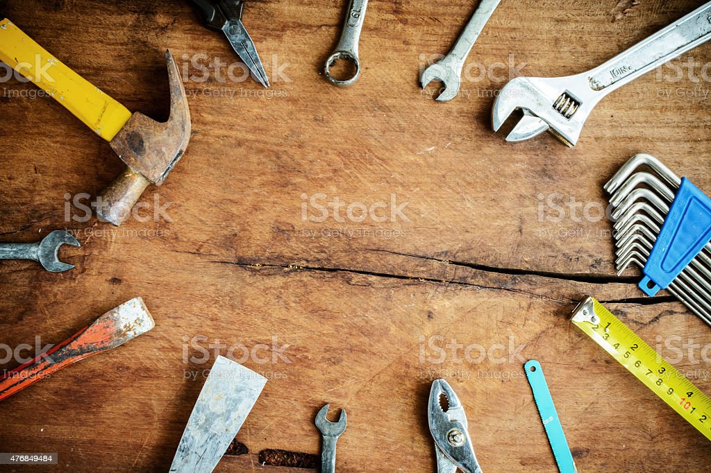 Set of work tools on old grunge wooden background stock photo