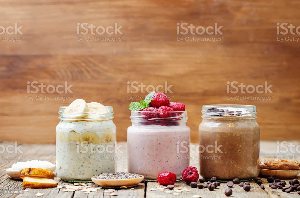 set overnight oats with berries, Chia seeds and chocolate chips stock photo