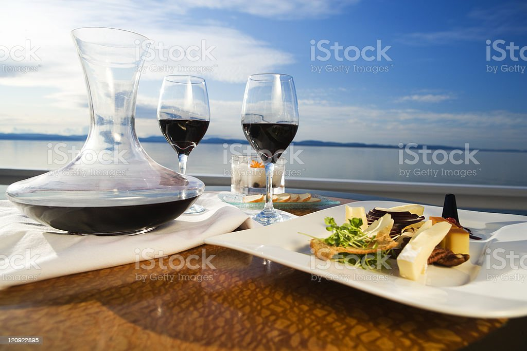 Set table with gourmet appetizer and two glasses on red wine royalty-free stock photo