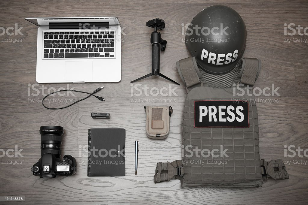 Set the photographer to work in conflict zones stock photo