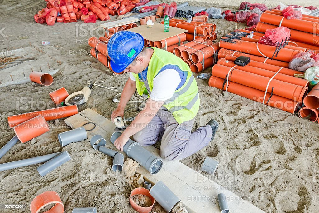 Set up sewer pipe to right length stock photo