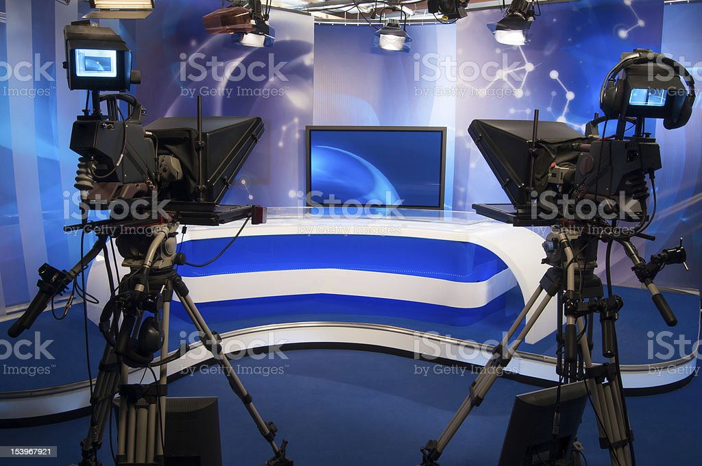 A TV set with cameras and a news desk stock photo