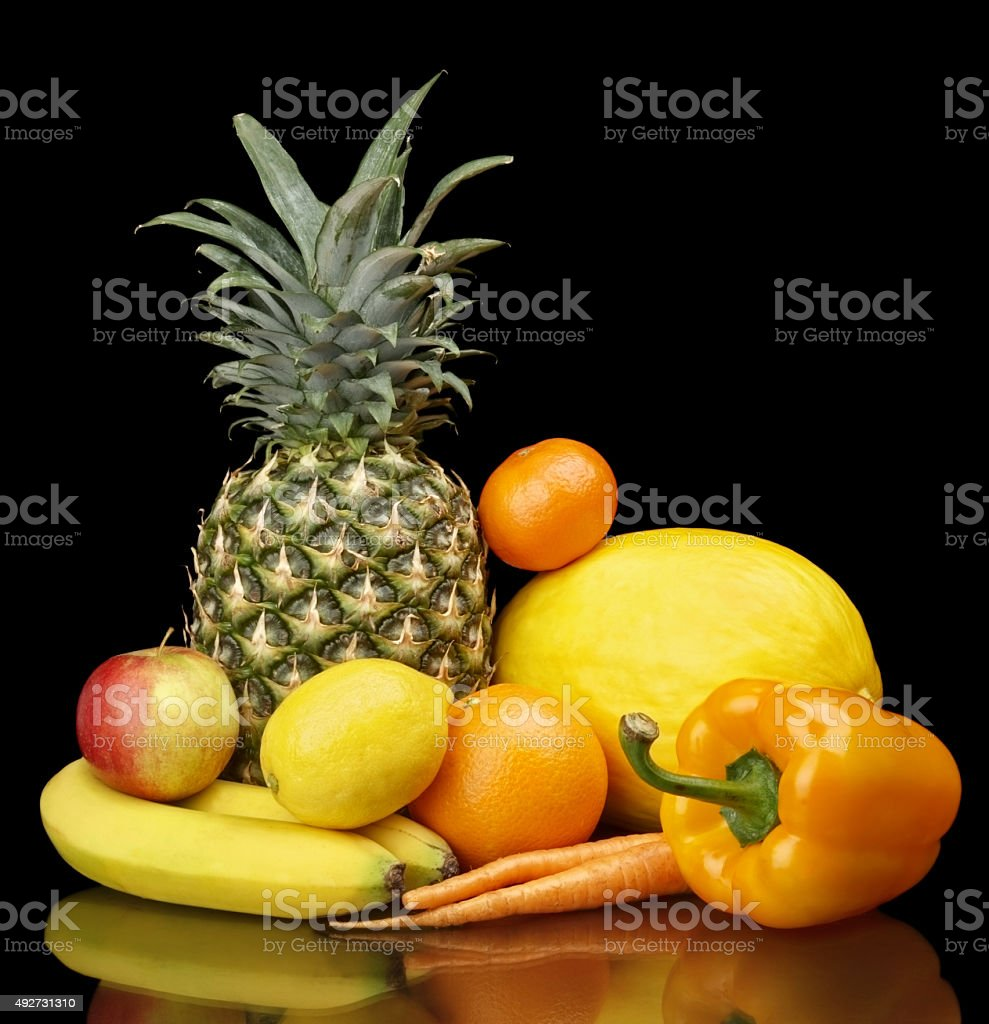 Set yellow fruits-mandarin,citrus,bananas on black at the bottom stock photo