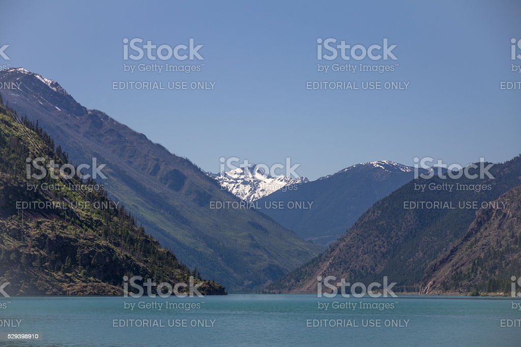 Seton Lake, BC, with snow-capped mountain in distance stock photo