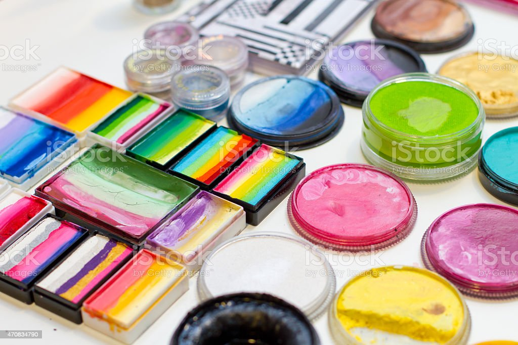 Sets of colorful face paints stock photo