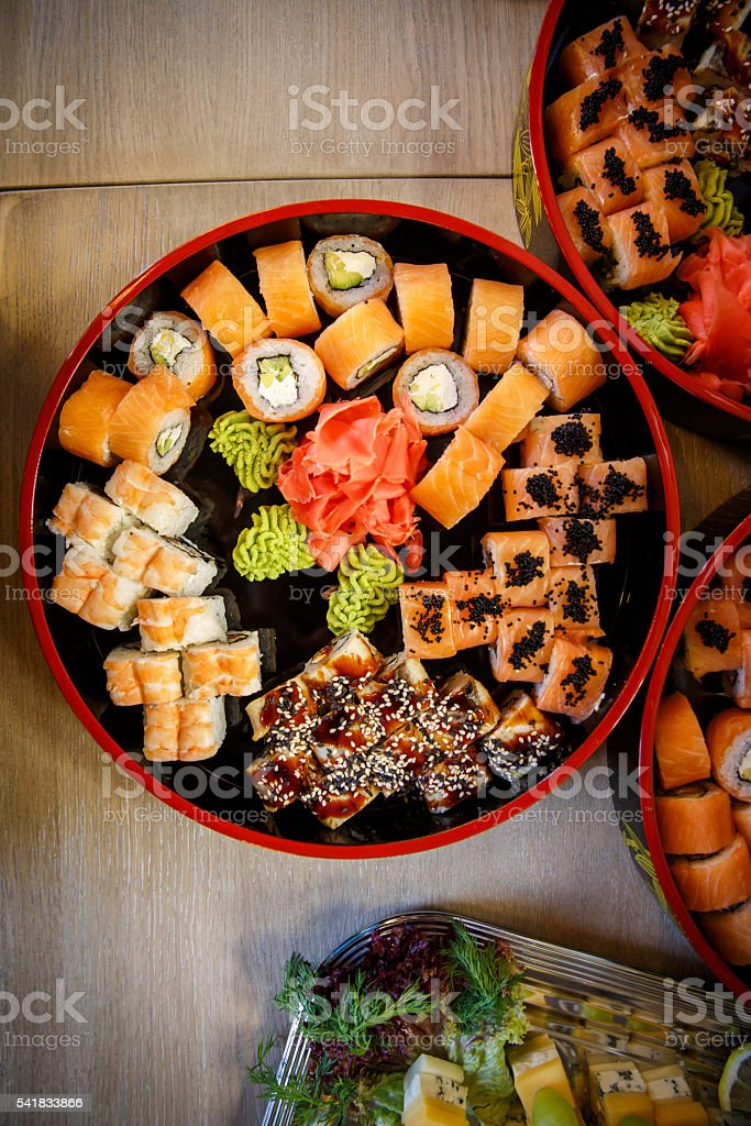 Sets of sushi nigiri, rolls and sashimi served in traditional stock photo