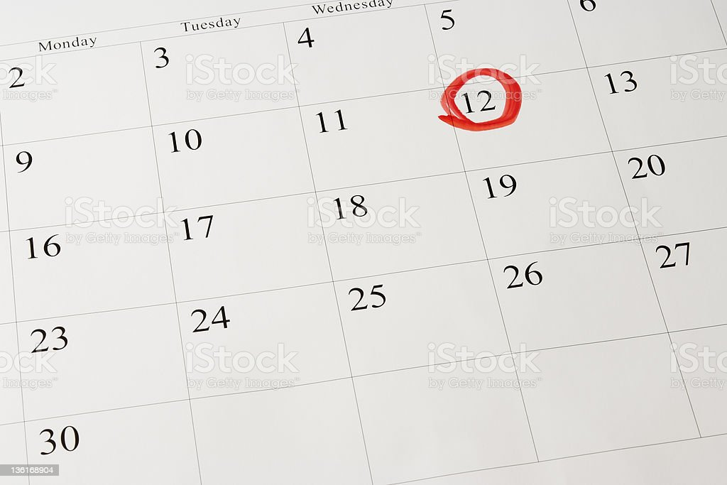 Setting a date on blank calendar by red pen royalty-free stock photo