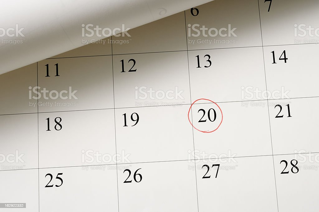 Setting a date on calendar by red pen royalty-free stock photo