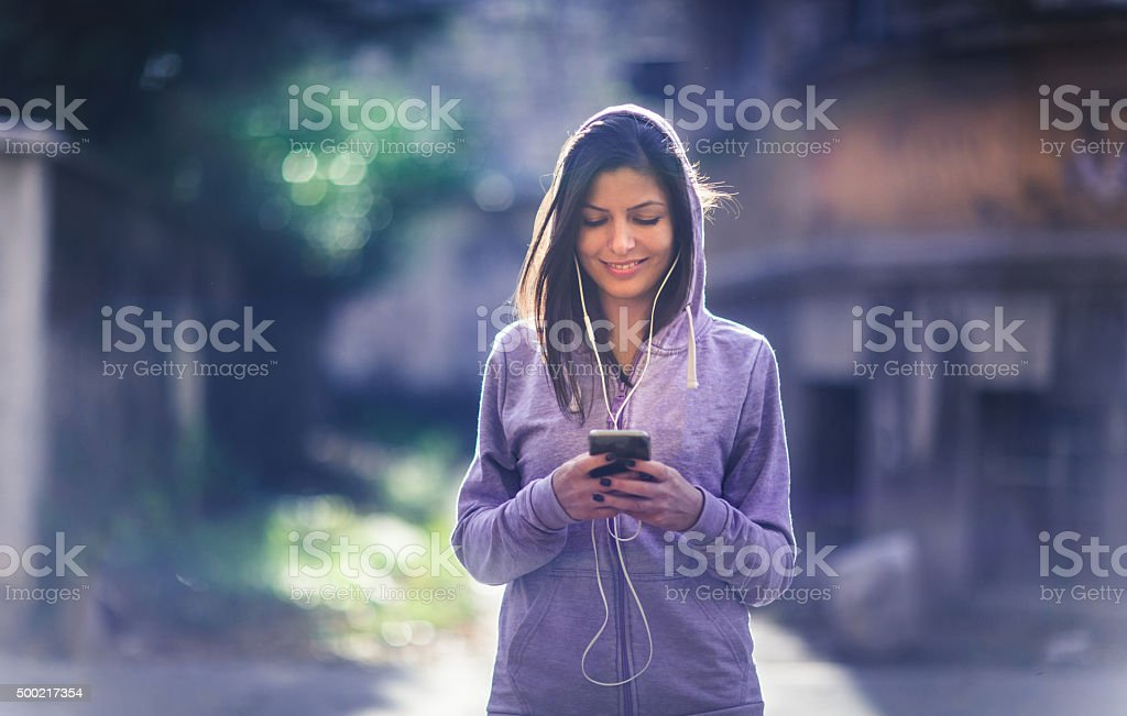 Setting music list for jogging! stock photo