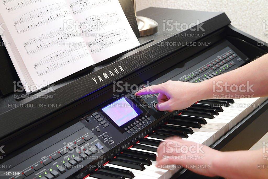 Setting sounds on Yamaha piano royalty-free stock photo