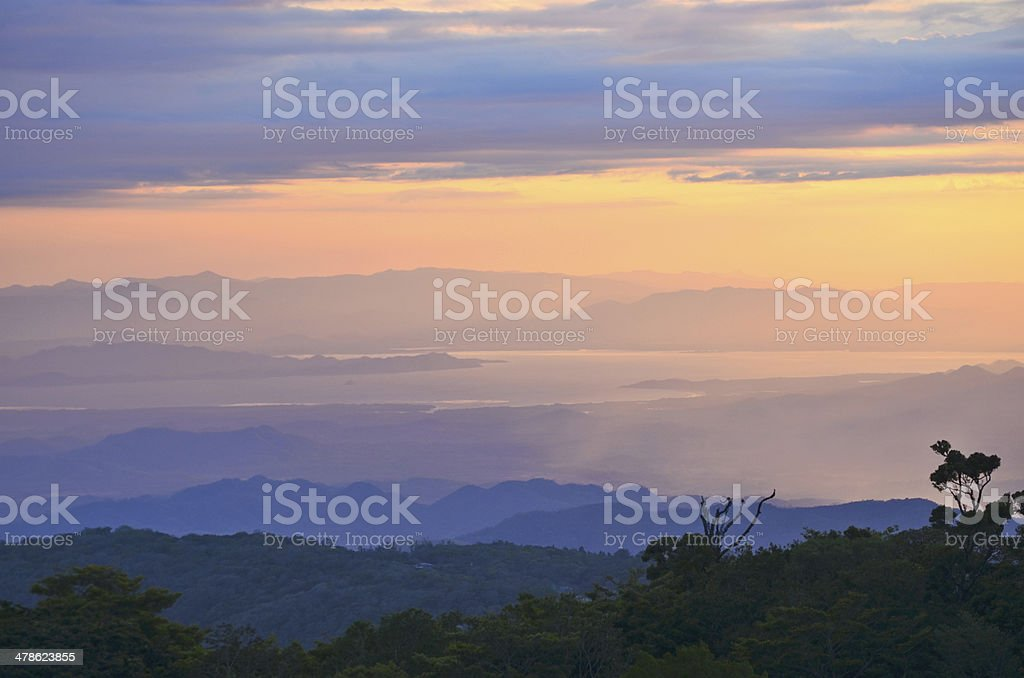 Setting sun at the Monteverde Cloud Forest Reserve stock photo