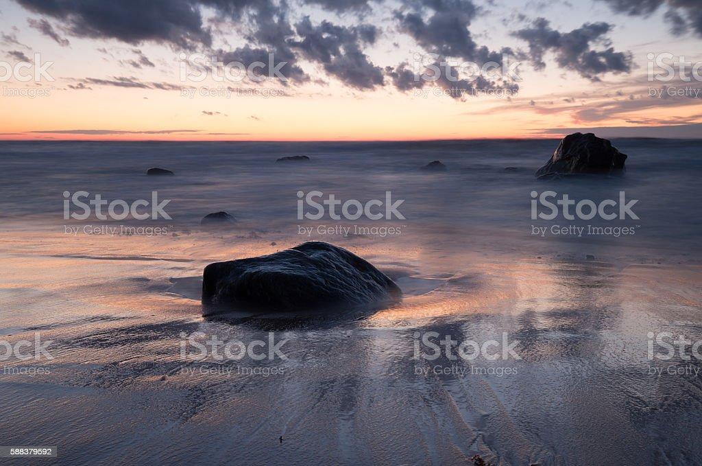 Setting sun over a swedish beach stock photo