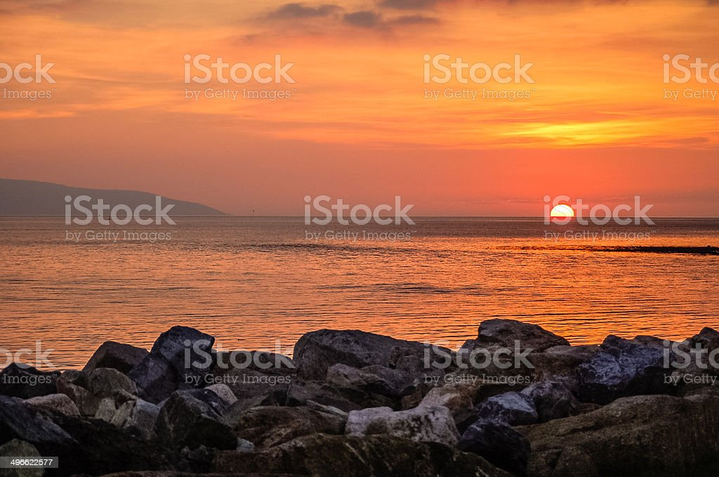 Setting Sun over Galway bay stock photo