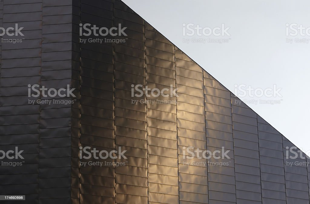 Setting Sun reflects on Lowry Centre Roof stock photo
