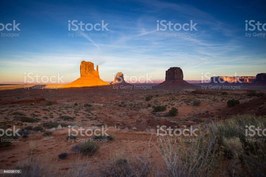 Setting Sun Shining on Monument Valley stock photo