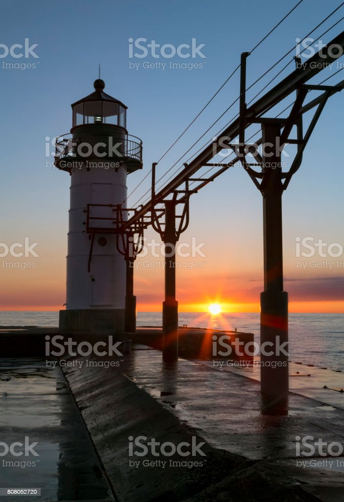 Setting Sun Silhouettes Lighthouse at St. Joseph stock photo