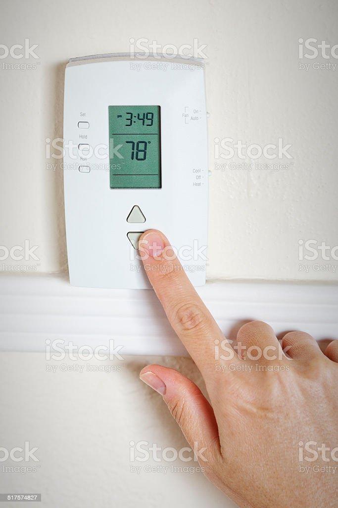 Setting the room temperature stock photo