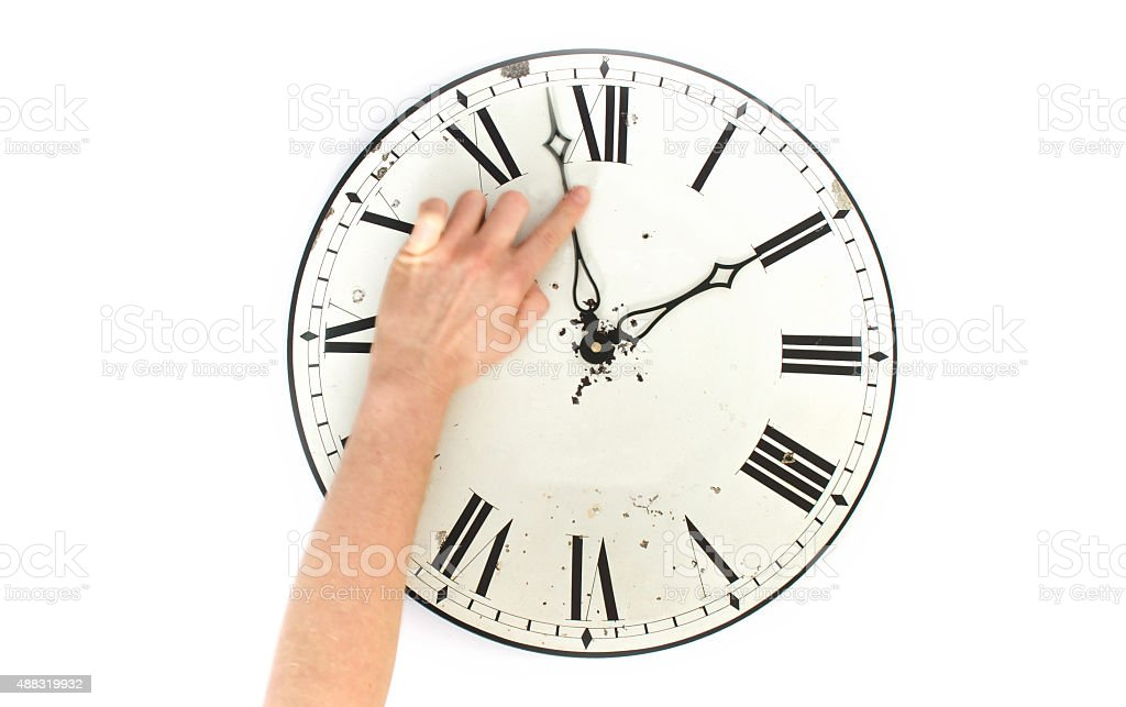 Setting the time on a wall clock stock photo