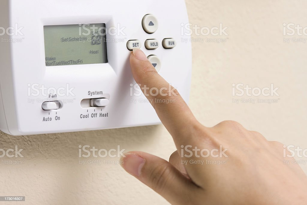 Setting thermostat stock photo