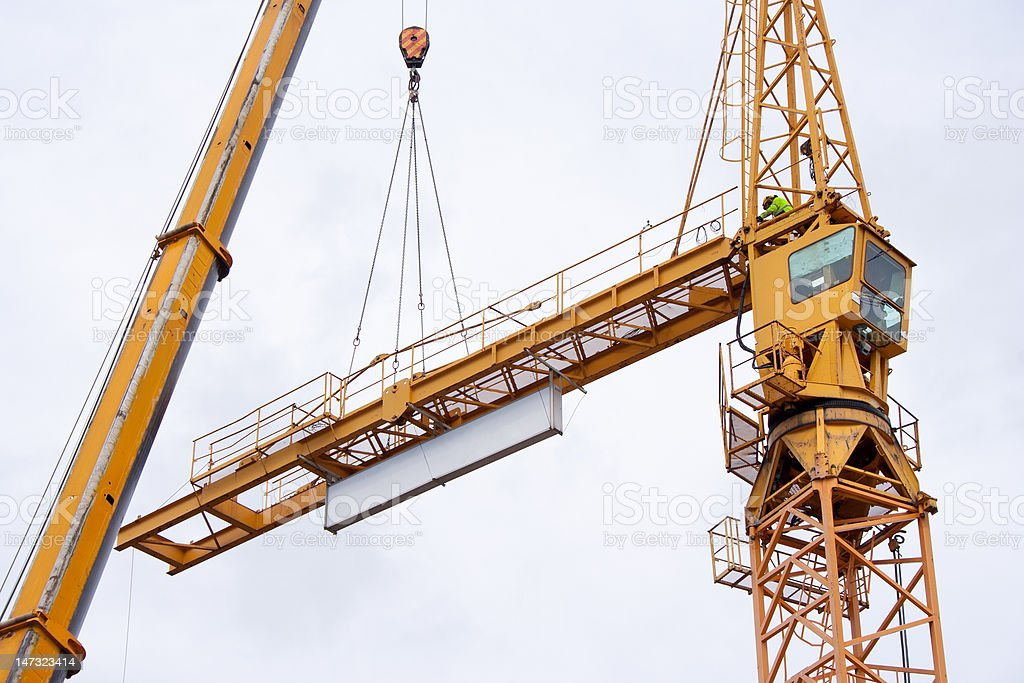 Setting up a tower crane royalty-free stock photo