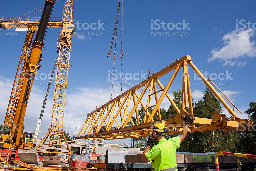 Setting up a tower crane stock photo