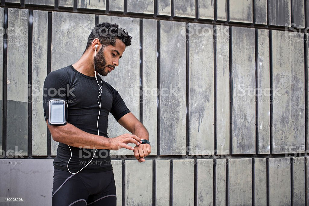 Setting up the smartwatch for running stock photo