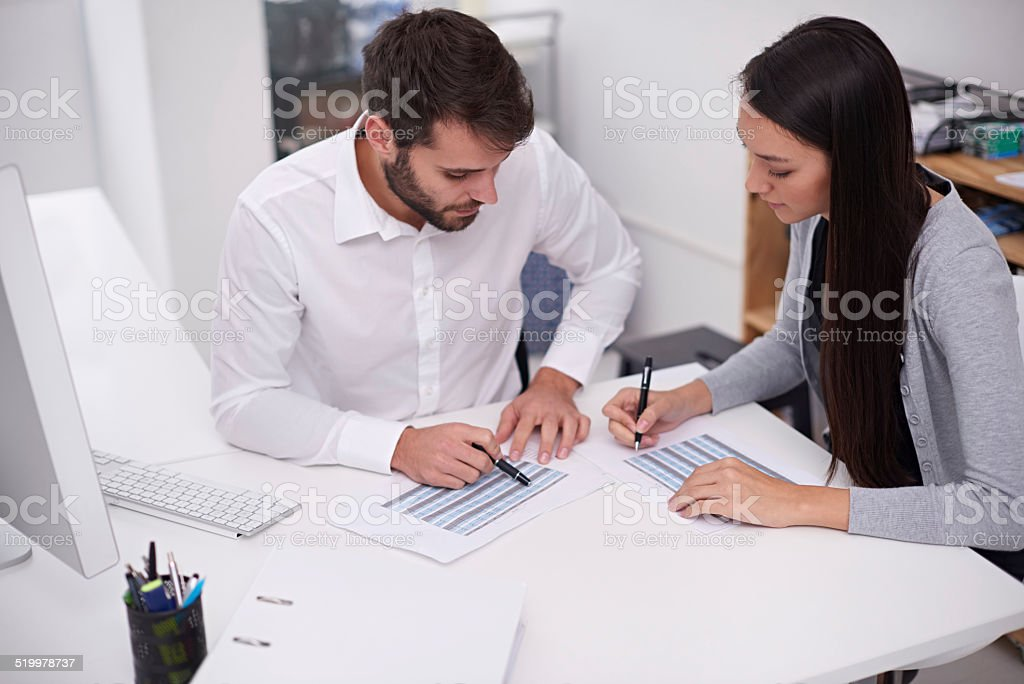 Setting up their monthly schedules stock photo