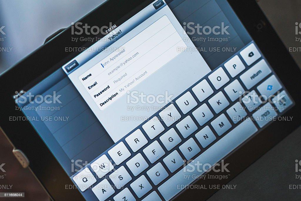 Setting up Yahoo! email on Apple iPad device stock photo