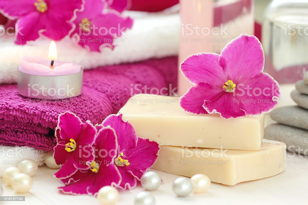 SPA setting with candles and fresh violets stock photo