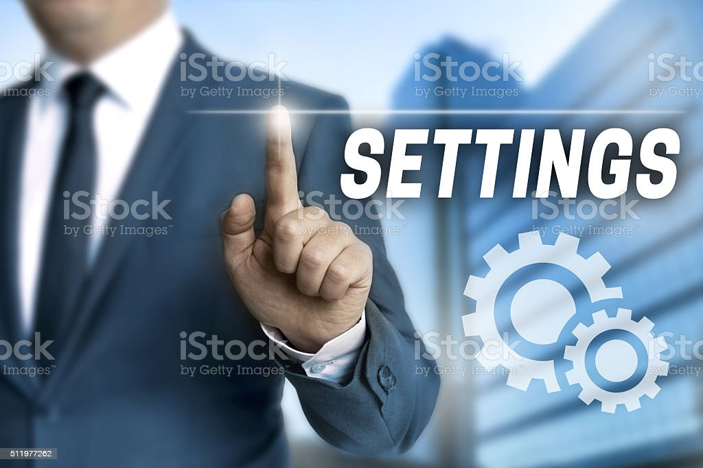 settings touchscreen is operated by businessman stock photo