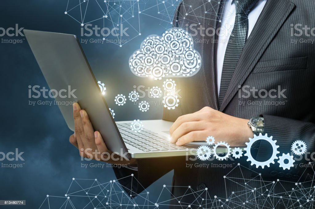 Setup data transfer from the cloud to the laptop. stock photo