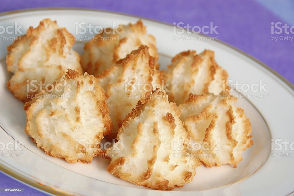 Seven coconut macaroons on a white plate stock photo