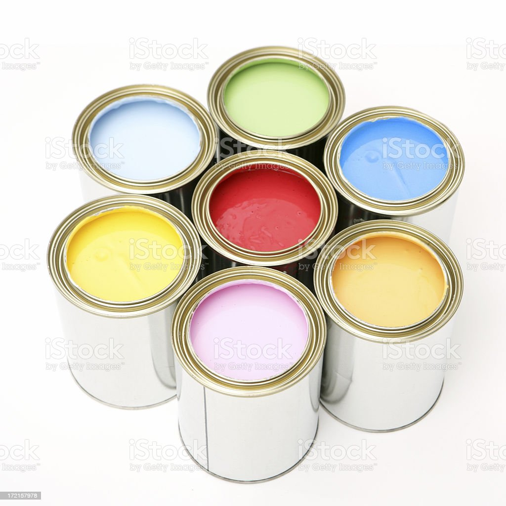 Seven colors of paint in cans forming a circle royalty-free stock photo